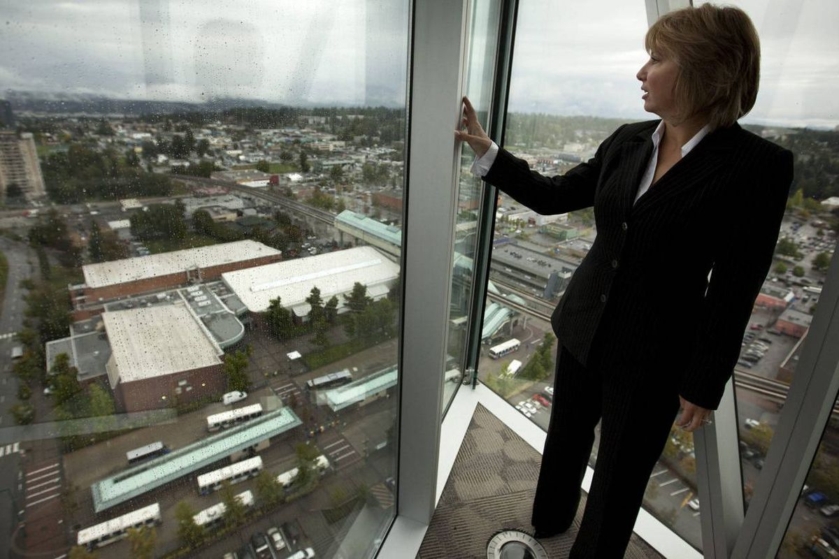 Surrey Mayor Dianne Watts stands with a view of the city.