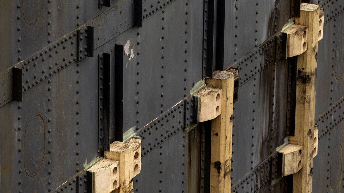 New wooden 'bumpers' have been placed on this steel lock door.