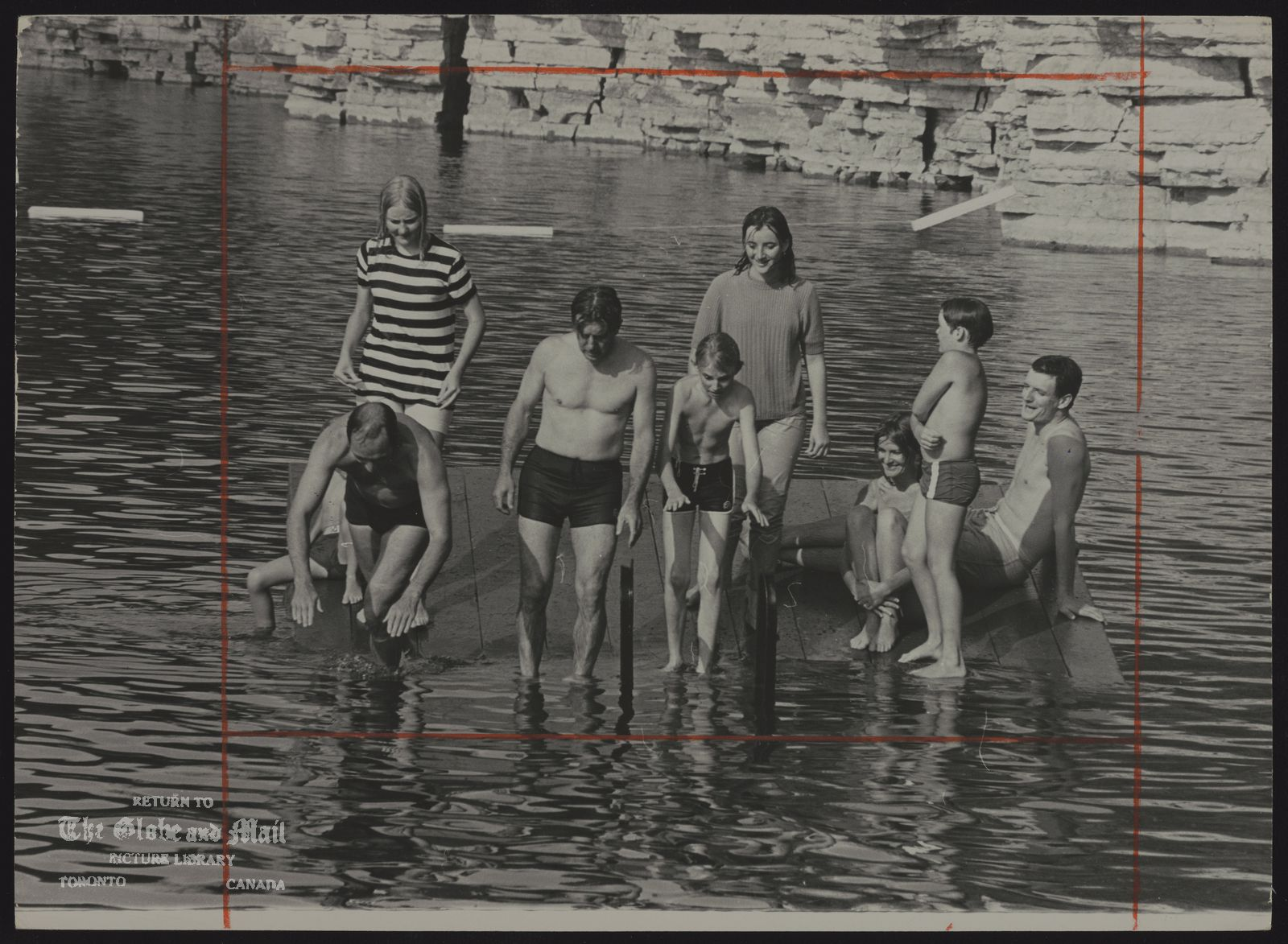 Pierre Elliott TRUDEAU Quebec. Politician St. Marys quarry near Stratford, Ontario. As the raft tips, so dives Prime Minister Trudeau (at left). Others on raft, including Forestry Development Minister Jean Marchand, young swimmers, and Globe and Mail reporter John Burns (right) looks on.
