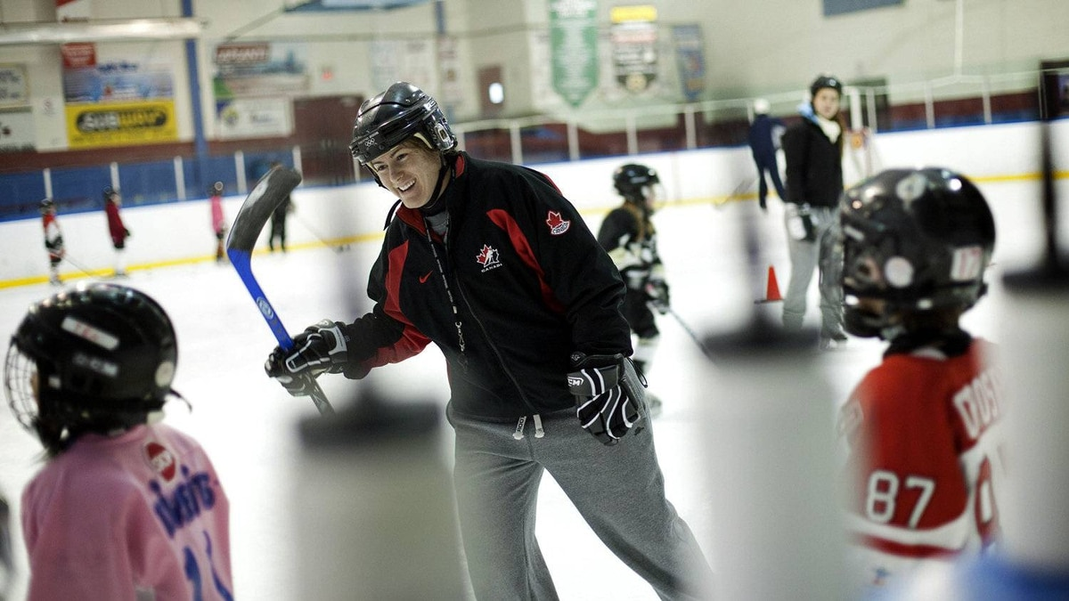Olympic gold medalist Katie Weatherston, who has suffered multiple concussions, teaches aspiring hockey players about the game in Rockland, Ont., on March 16, 2011.