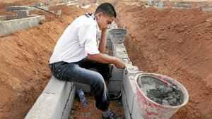 Boy Scout Mohammed El-Bagrmi, 16, is an engineering student who says before the war, they mostly played soccer.