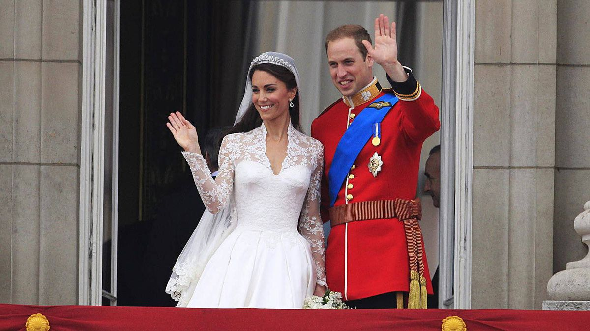 Prince William and his wife Kate, Duchess of Cambridge wave from the balcony of Buckingham Palace after the Royal Wedding in London Friday, April, 29, 2011.