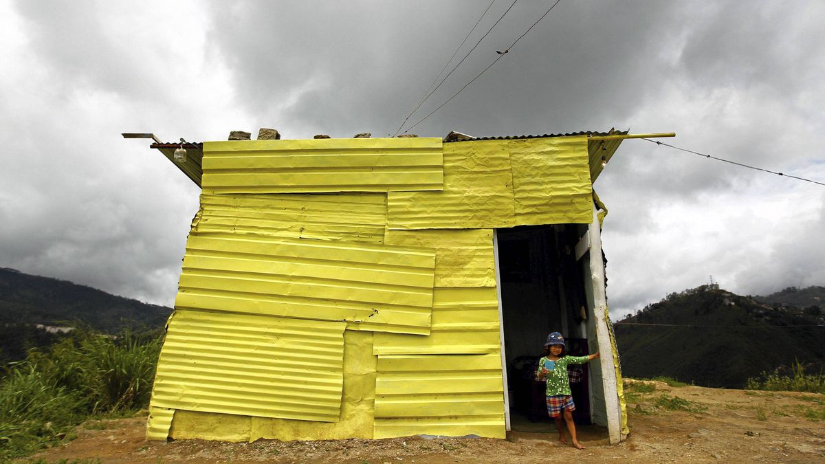 "Leyerly, 3, stands at the door of her shack in Las Mayas. Venezuelan President Hugo Chavez has promised a ""Grand Housing Mission"" - his eighth such construction plan - aiming to build 2 million new units by 2017 with funds available from higher global oil prices."