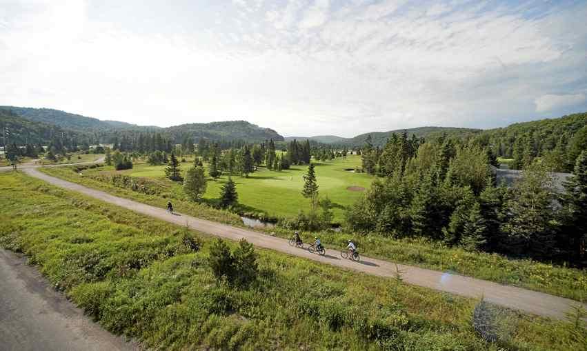 The bike route P'tit Train du Nord follows an old train route through the Laurentians in Quebec.