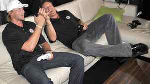Hockey stars Steven Stamkos (left) and Jeremy Roenick celebrate a goal while playing EA Sports NHL 12 during an exclusive Xbox holiday preview event in Toronto, Thursday, August 18, 2011. The Canadian Press Images PHOTO/Xbox Canada