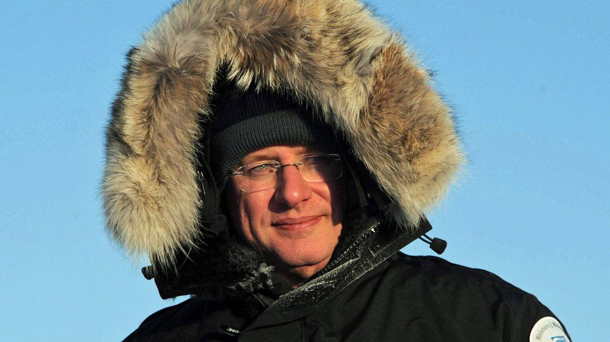 Prime Minister Stephen Harper bundles up in a parka as he tours Frobisher Bay, in Iqaluit, on Feb. 23, 2012.