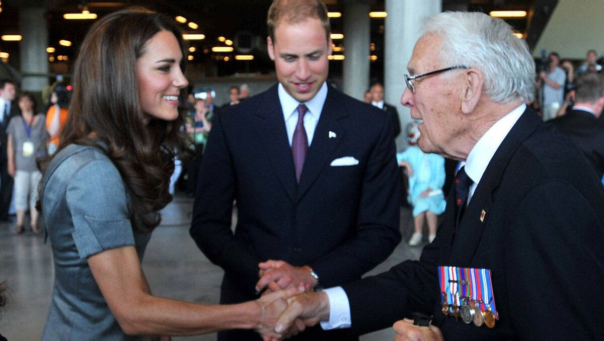 Catherine, Duchess of Cambridge and Prince William, Duke of Cambridge meet Canadian Royal Navy veteran Lieutenant Kenneth Mathewson-Porter while visiting the Canadian War Muesum on July 2, 2011 in Ottawa, Canada.