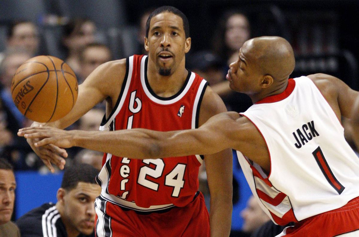 Toronto Raptors forward Jarrett Jack tries to block a pass by Portland Trail Blazers guard Andre Miller, left, during the first half of their NBA basketball game in Toronto February 24, 2010.
