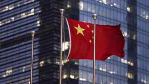 The Chinese national flag is seen in the financial district of Pudong in Shanghai September 22, 2011.