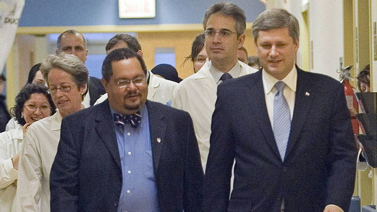 Prime Minister Stephen Harper chats with Dr. Arthur Porter at a Montreal hospital on Nov.24, 2006.