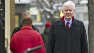 Interim Liberal Leader Bob Rae strolls back to his car after giving a year-end news conference in Toronto on Dec. 30, 2011.