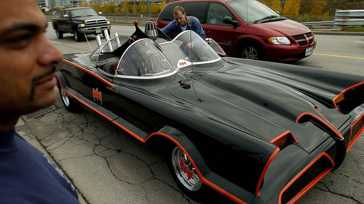 Shane Joachim (left) and Brad Velema (right) prepare to load one of the original Batmobiles from the famous television sitcom into a truck for transport back to the Guild of Auto Restorers in Bradford, Ontario. This is one of only 12 Batmobiles made for the show. The car was built on a 1955 Lincoln Premiere Chassis which was extended by 11 inches. Powered by a Ford 429 Cobra Jet engine, it has a 20-foot fibreglass body. It is equipped with a functioning Bat phone, sirens, smokescreen and colour TV. It weighs 3800 lbs.