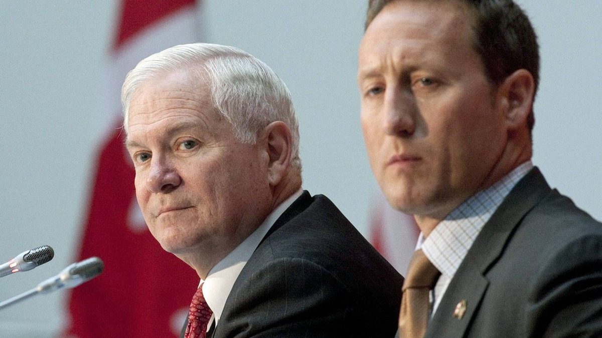U.S Secretary of Defence Robert Gates and Defence Minister Peter MacKay take questions at an Ottawa news conference on Jan. 27, 2011.