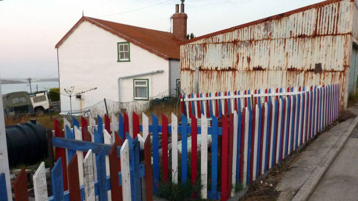 A house with its picket fences painted with the colors of the Union Jack is seen in Stanley, Falkland Islands.
