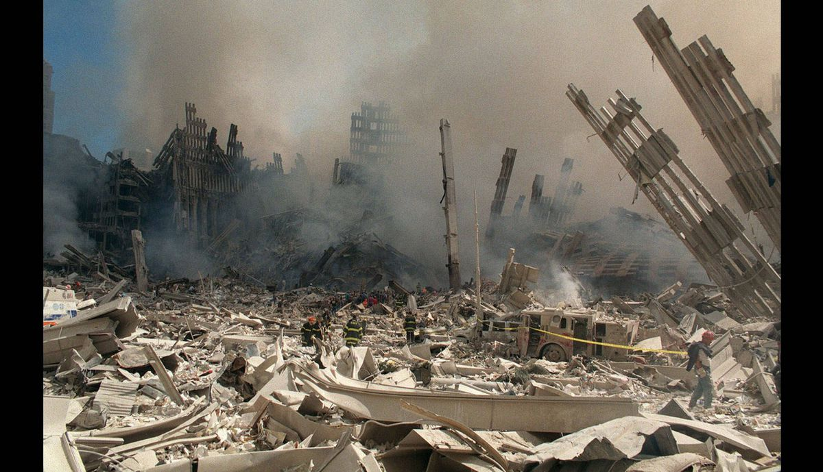 Firefighters work in the rubble of the World Trade Center towers in New York on Sept. 12, 2001. The towers collapsed Tuesday after being struck by two commercial aircrafts in a terrorist attack.
