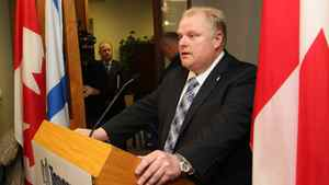 Toronto Mayor Rob Ford talks to the media during a press conference on his first day as a mayor
