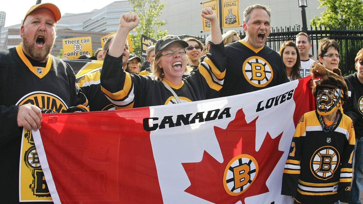 Boston Bruins fans from Canada show their support for the Bruins outside the arena before Game 6 of the NHL hockey Stanley Cup Finals between the Bruins and the Vancouver Canucks, Monday, June 13, 2011, in Boston.