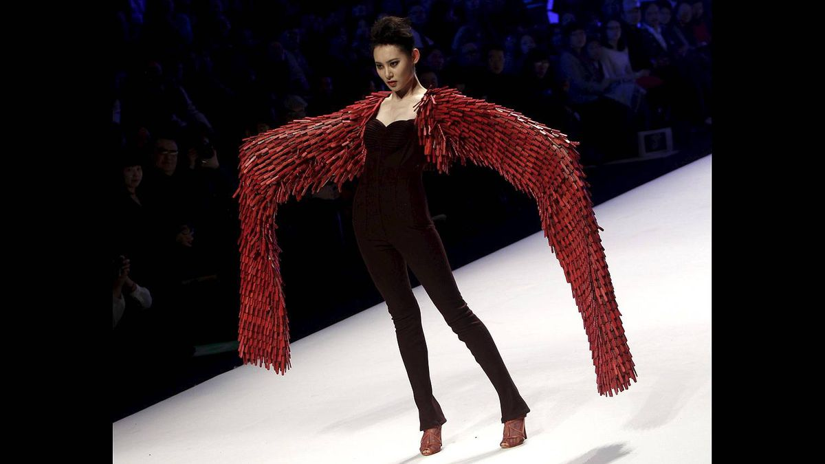 A model presents a creation during China Fashion Week in Beijing March 25, 2011.