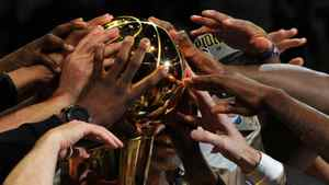 The Dallas Mavericks celebrate defeating the Miami Heat 105-95 in Game 6 to win the NBA Finals. Getty Images / Don EMMERT