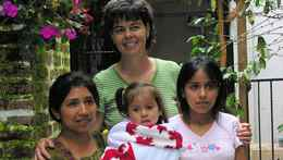 Robin Pawliuk with a family in in Guatemala
