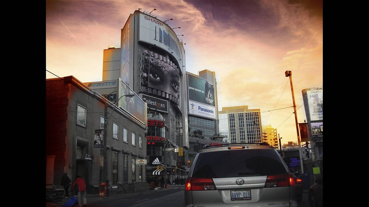 Michael Derblich photo: 10 Dundas East - The much-criticized building is actually a great example of form following function. Ads on the outside as is the theme of Dundas square, and an interesting layout for retail and entertainment inside.