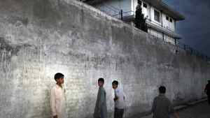 The boys who lived across the street from Osama bin Laden's former home in Abbottabad, Pakistan, say they could hear the voices of the children living in the compound on the other side of this wall but never saw them leave the house.