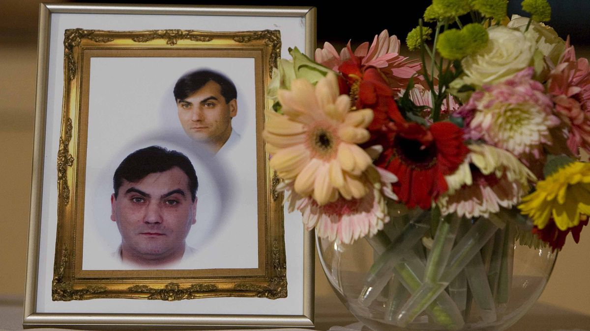 A photo of Robert Dziekanski, who was killed by a taser gun at the hands of RCMP at the Vancouver International Airport, sits on a table beside flowers at a press conference in Vancouver, B.C. October 25, 2007.