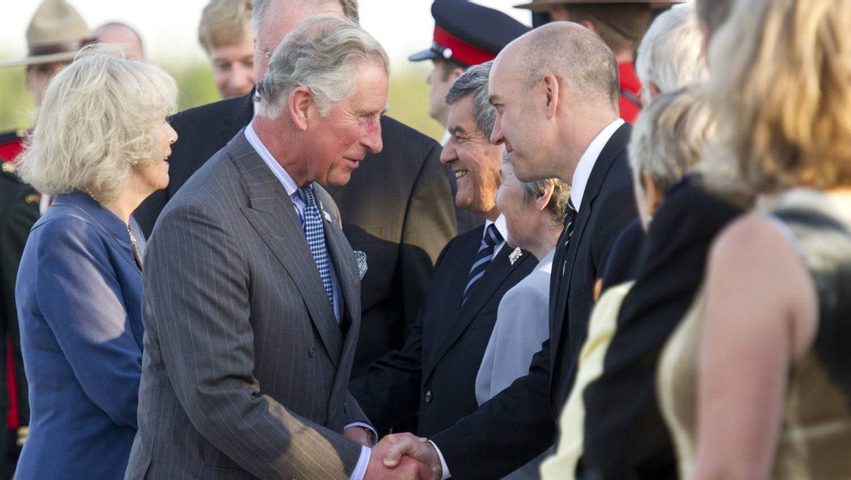 Prince Charles and his wife Camilla are greeted as they arrive Sunday, May 20, 2012 in Fredericton, N.B. The royal couple begin a four-day visit to Canada to mark the Queen's Diamond Jubilee.