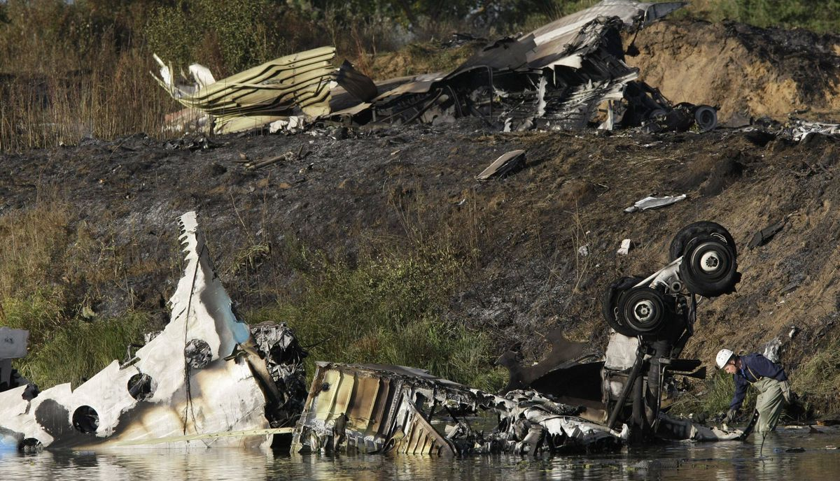 Wreckage of Russian Yak-42 jet, carrying a top ice hockey team, seen near the city of Yaroslavl, on the Volga River about 150 miles (240 kilometers) northeast of Moscow, Russia, Wednesday, Sept. 7, 2011.