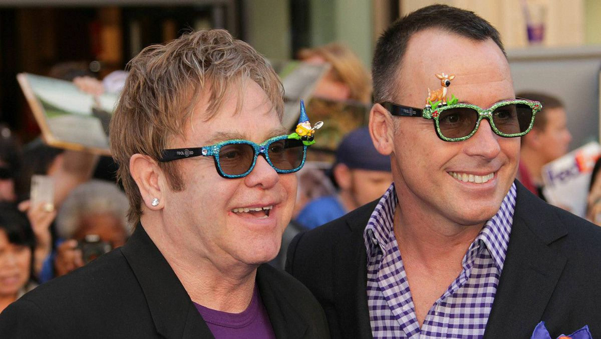 Sir Elton John, left, and husband David Furnish are reportedly invited to see Prince William and Kate Middleton wed later this month.