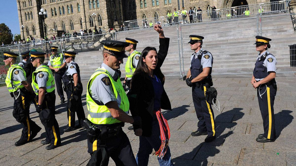 Police arrest a protester on Parliament Hill during a demonstration against the proposed Keystone XL pipeline on Sept. 26, 2011.