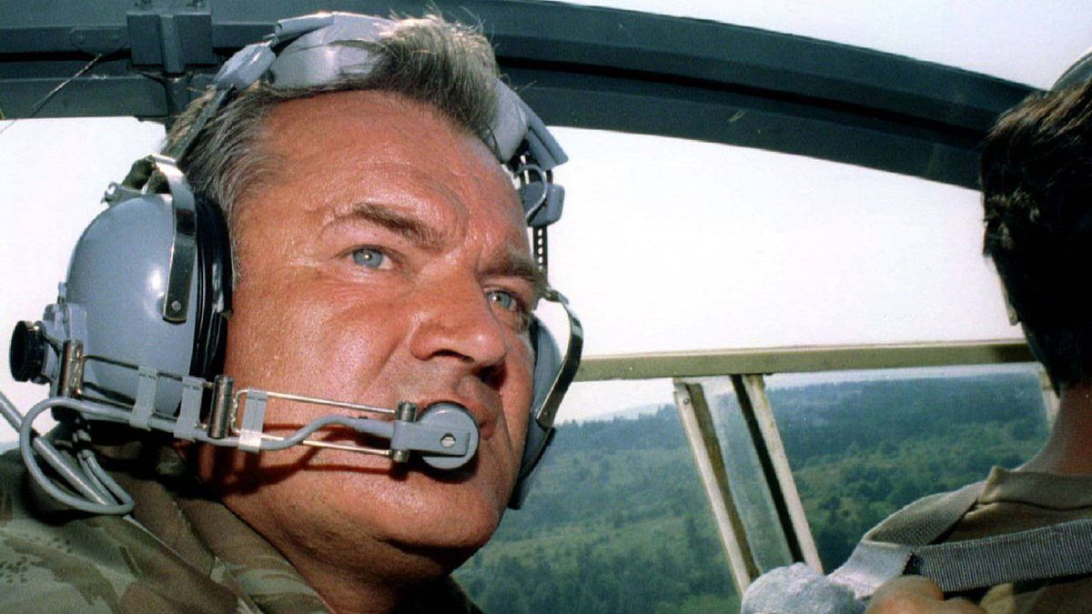 Bosnian Serb army Commander Gen. Ratko Mladic travels in a helicopter near the eastern Bosnian town of Zepa in this July 29, 1995 file photo.