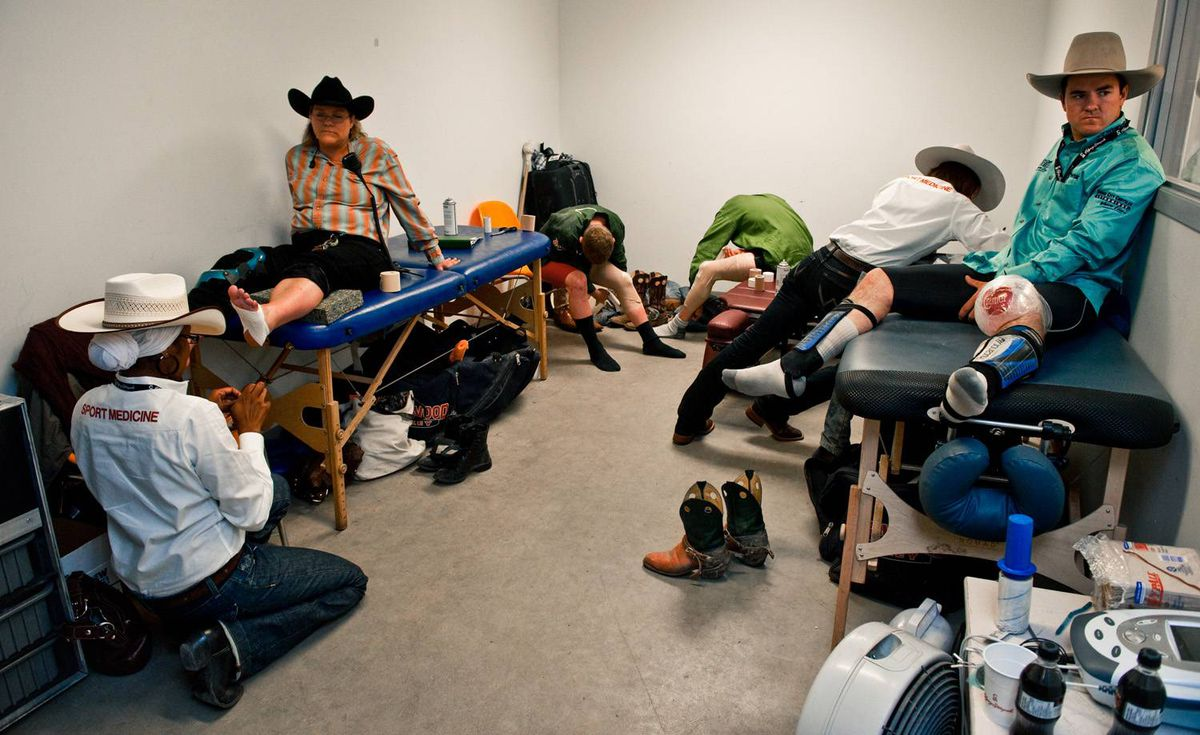 Rodeo pariticipants prepare for competition in the medical room on day six of the Calgary Stampede Rodeo.