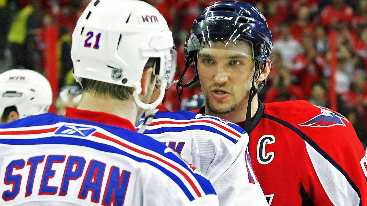 Alex Ovechkin #8 of the Washington Capitals consoles fellow countrymen Marian Gaborik #10 of the New York Rangers during the handshake following a 3-1 loose in Game Five of the Eastern Conference Quarterfinals during the 2011 NHL Stanley Cup Playoffs at the Verizon Center on April 23, 2011 in Washington, DC. (Photo by Len Redkoles/Getty Images)