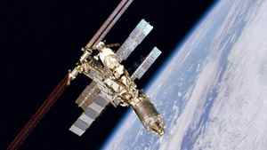 This Feb. 16, 2001 file photo provided by NASA, shows the International Space Station as it orbits the Earth. A discarded chunk of a Russian rocket is forcing six space station astronauts to seek shelter in escape capsules early Saturday, March 24, 2012.