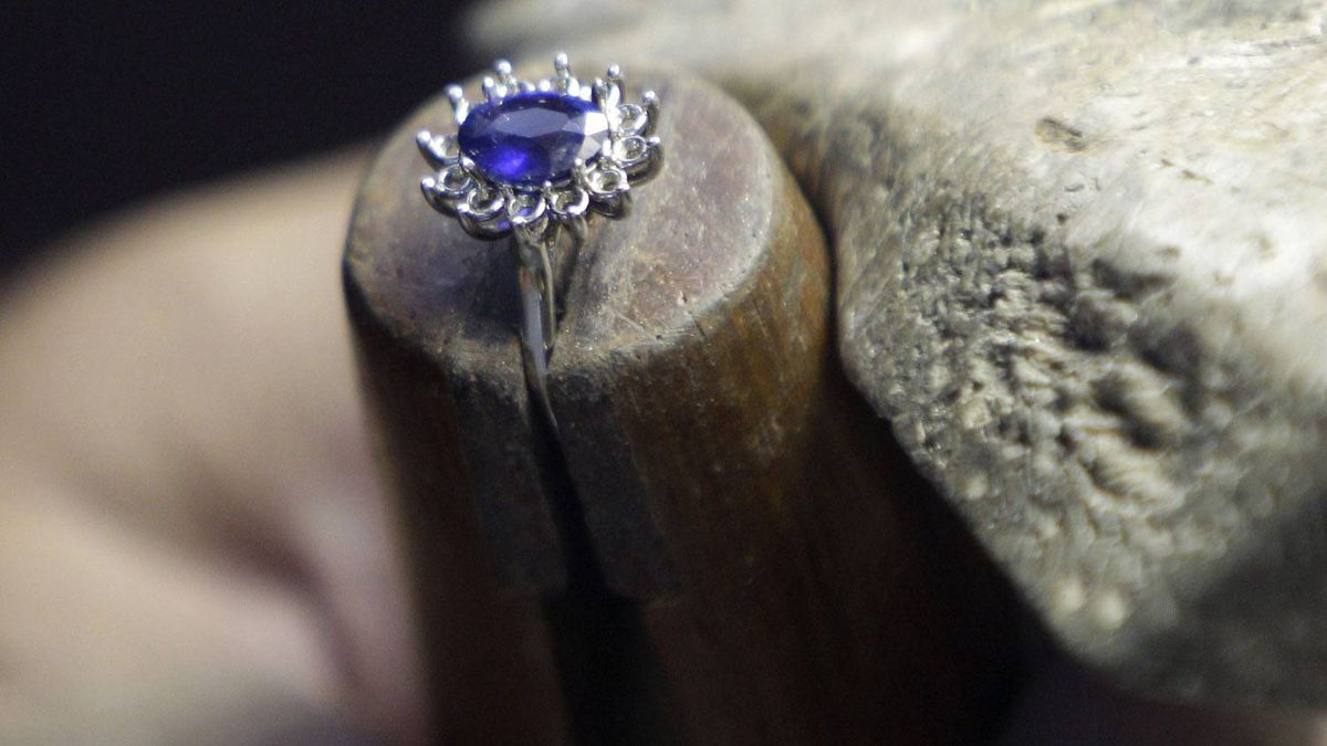 A close-up of Frank Soto's replica of the engagement ring Prince William gave to his fiancee Kate Middleton at Natural Sapphire Co. in New York. Minutes after the world first saw the ring - an oval blue sapphire surrounded by diamonds that once belonged to William's late mother, Diana, Princess of Wales - the phones started ringing off the hook at the Manhattan jewelry maker.