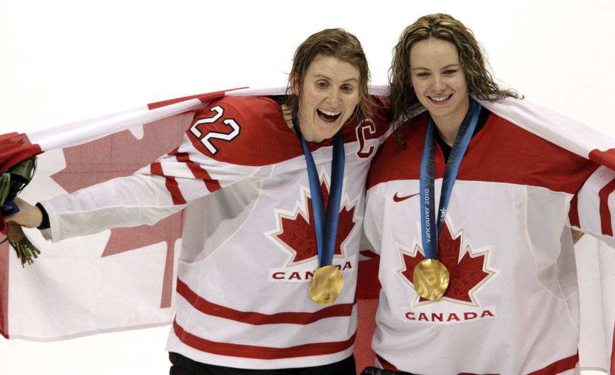Hayley Wickenheiser , left, and Shannon Szabados celebrate Canada's 2-0 victory over the U.S. in the gold medal game at the Vancouver Olympics.