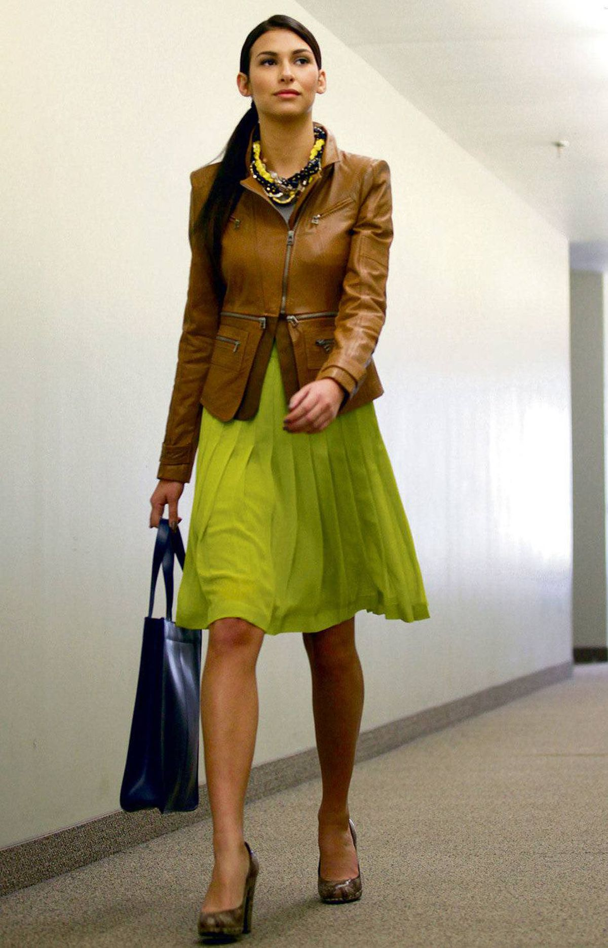 Sheer pleats, the real way BCBG skirt, $214, top, $82, jacket, $958 at BCBG. Kate Spade necklace, $395 at Holt Renfrew. Joe Fresh tote, $99 at Joe Fresh. Stuart Weitzman pumps, $350 at Davids. Styling by Alon Freeman/Judy Inc.; hair and makeup by Robert Weir for M.A.C. Cosmetics/Ford Artists.