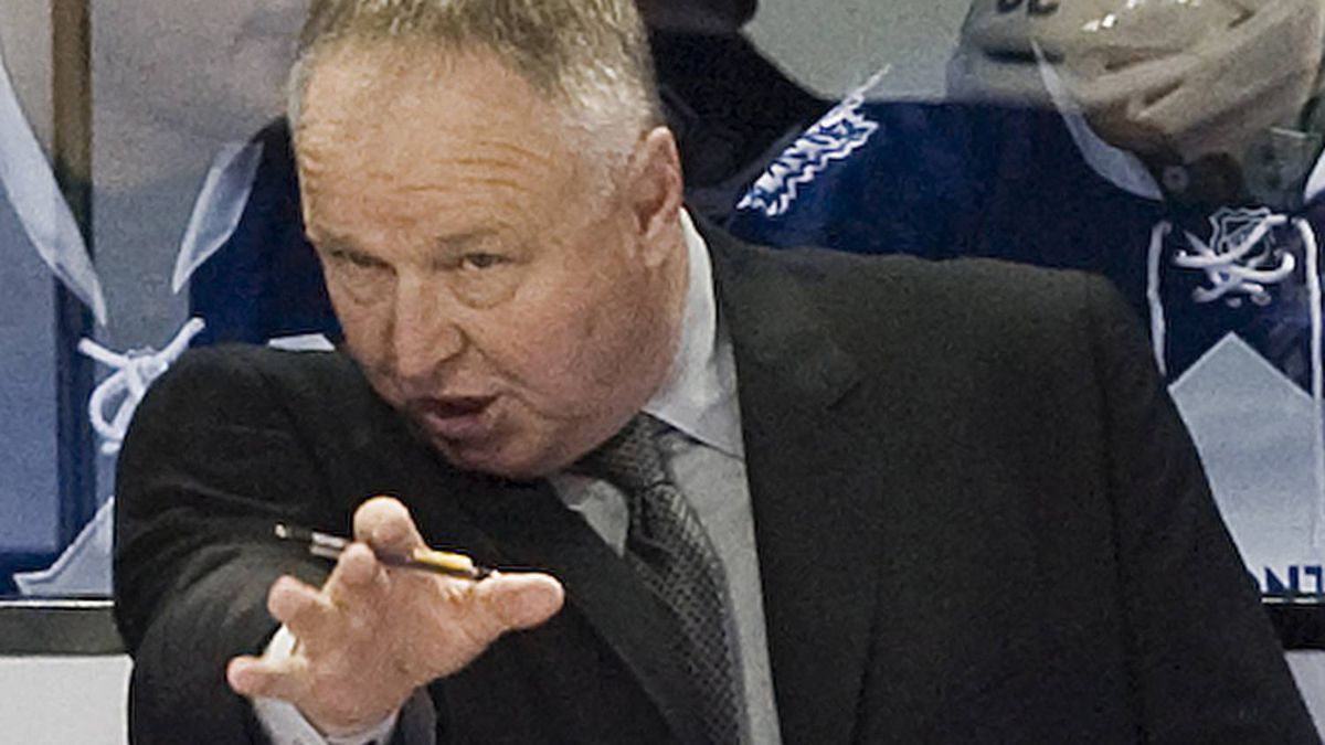 Toronto Maple Leafs head coach Randy Carlyle talks with players during first period NHL hockey game action against the Montreal Canadiens in Montreal, Saturday, March 3, 2012. THE CANADIAN PRESS/Graham Hughes