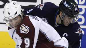 Colorado Avalanche's Matt Duchene (9) puts a hard check into Winnipeg Jets' Andrew Ladd (16) during second period NHL hockey action in Winnipeg, Sunday, February 19, 2012. The Jets won 5-1. THE CANADIAN PRESS/Trevor Hagan