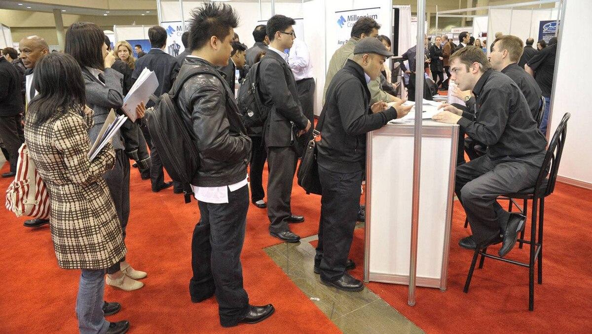 Job seekers attend a recent employment fair in Toronto.