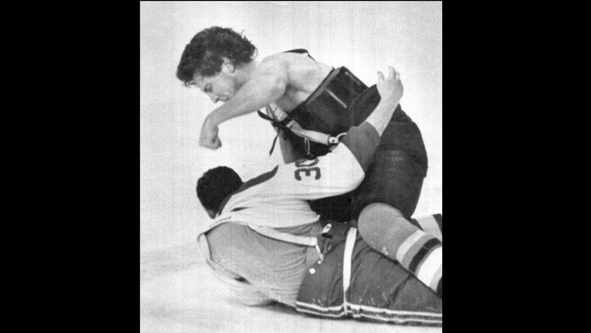 Philadelphia Flyer Dave Brown takes aim at Montreal Canadien Chris Nilan (bottom) during a brawl that took place prior to the start of the sixth playoff game at the Montreal Forum, May 14, 1987.