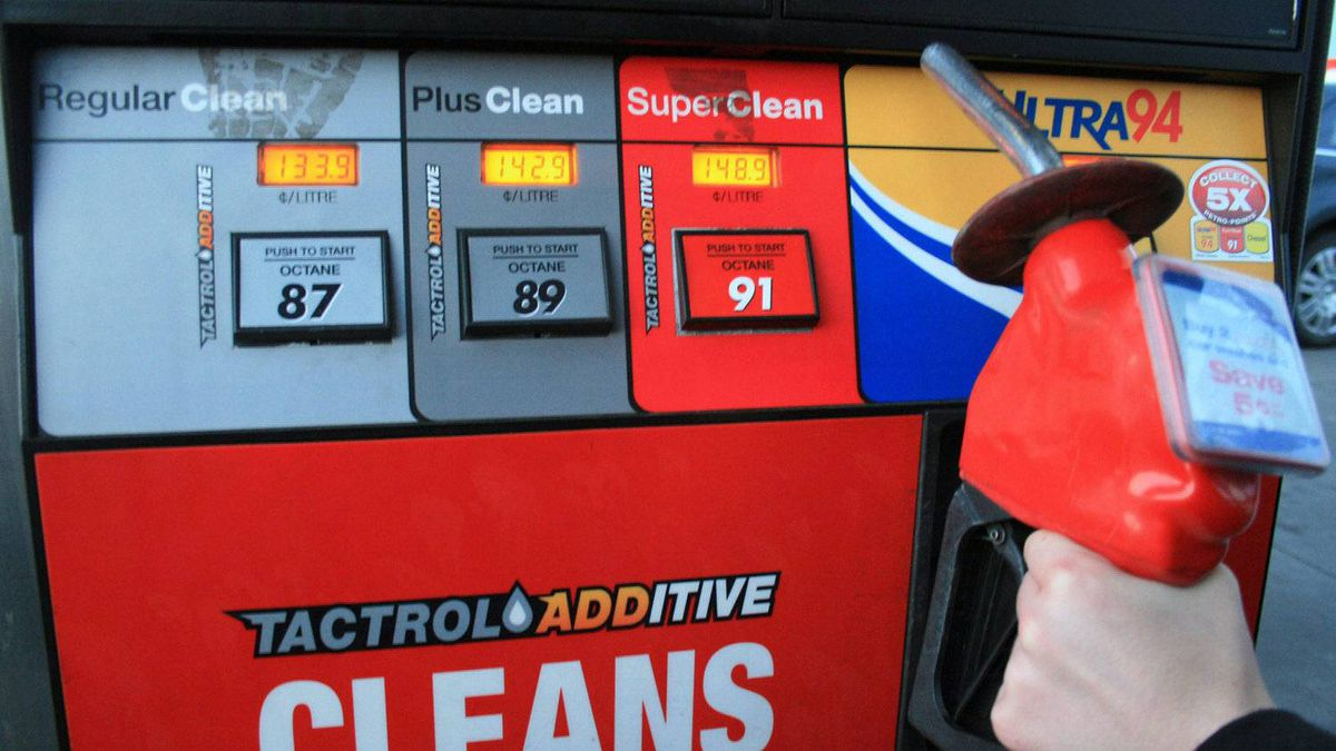 A customer holds a gas nozzle in Oakville, Ont., April 20, 2011.