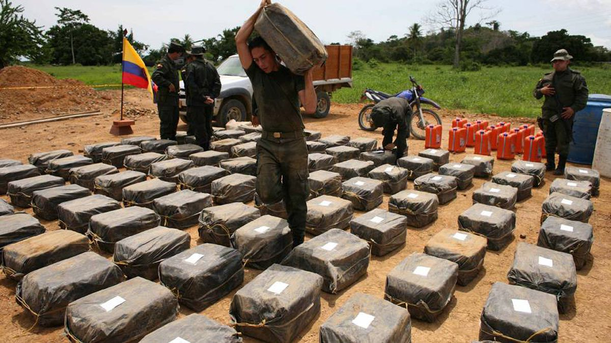 Counter narcotics police officers inspect packages containing cocaine seized in Necocli, in northwestern Colombia, Saturday, May 30, 2009.