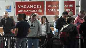 Passengers wait to rebook their flights after Air Canada baggage handlers walked off the job at Pierre Trudeau airport in Montreal, March 23, 2012.