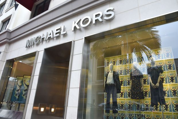 99796ec3f639 The business of fashion  A look at Michael Kors  purchase of Versace ...
