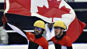 Canada's Charles Hamelin, left, celebrates his gold medal with teammate and silver medallist Michael Gilday in the the men's 1000-metre final at the ISU Korean Air World Cup short track speed skating Sunday, October 30, 2011 in Saguenay Que. THE CANADIAN PRESS/Jacques Boissinot
