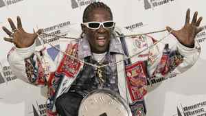 Musician Flavor Flav poses backstage at the 2006 American Music Awards November 21, 2006 in Los Angeles.