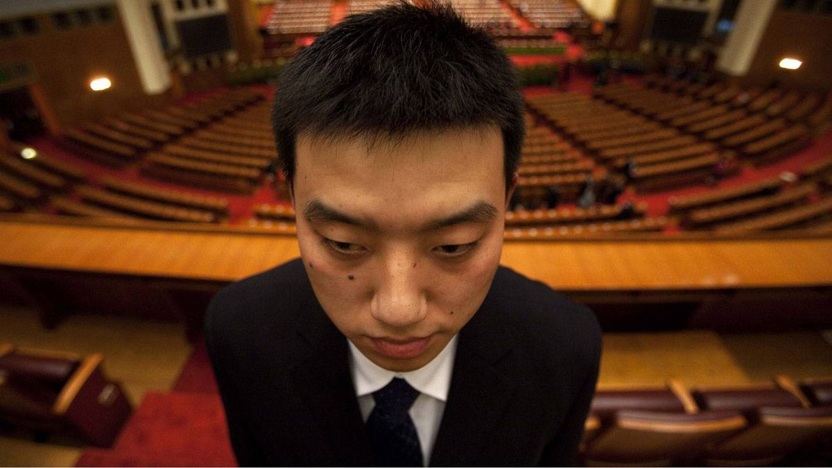 A security guard stands on duty after the opening session of the Chinese People's Political Consultative Conference in Beijing's Great Hall of the People, China, Thursday, March 3, 2011.