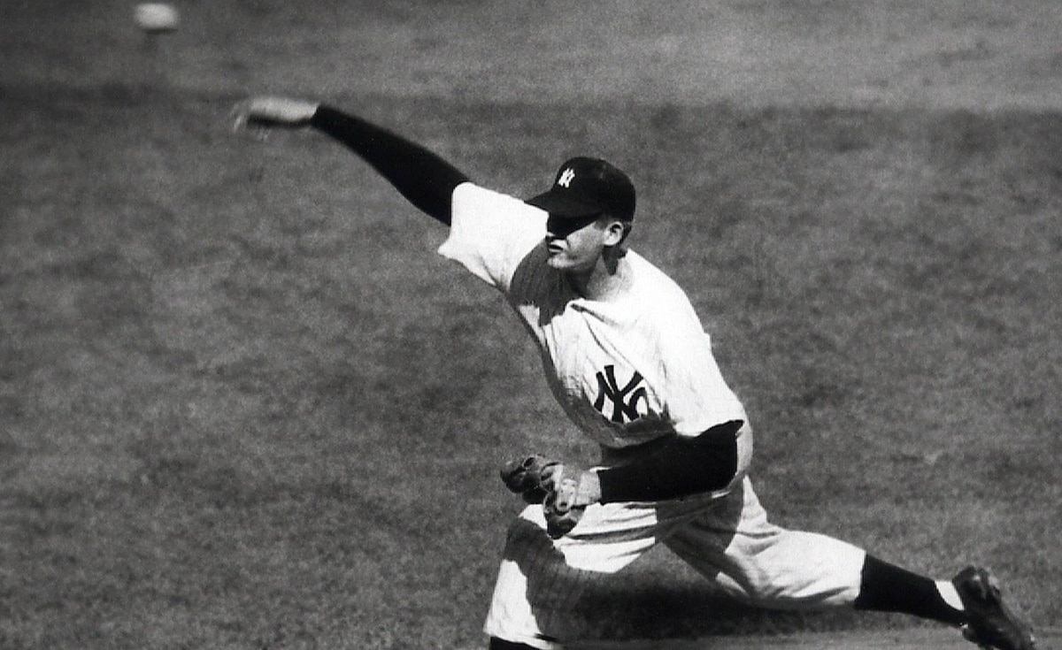 This Oct. 8, 1956, file photo, shows New York Yankees pitcher Don Larsen throwing against the Brooklyn Dodgers, enroute to a perfect game in the fourth inning of Game 5 of the World Series, in New York. Roy Halladay threw the second no-hitter in postseason history, leading the Philadelphia Phillies over the Cincinnati Reds 4-0 in Game 1 of the NL division series on Wednesday, Oct. 6, 2010. Larsen is the only other pitcher to throw a postseason no-hitter. (AP Photo/File)
